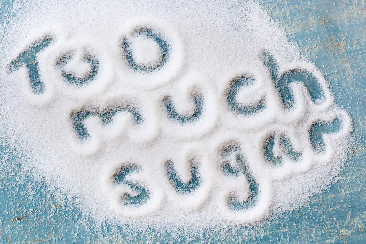 The phrase 'Too much sugar' written into sugar.