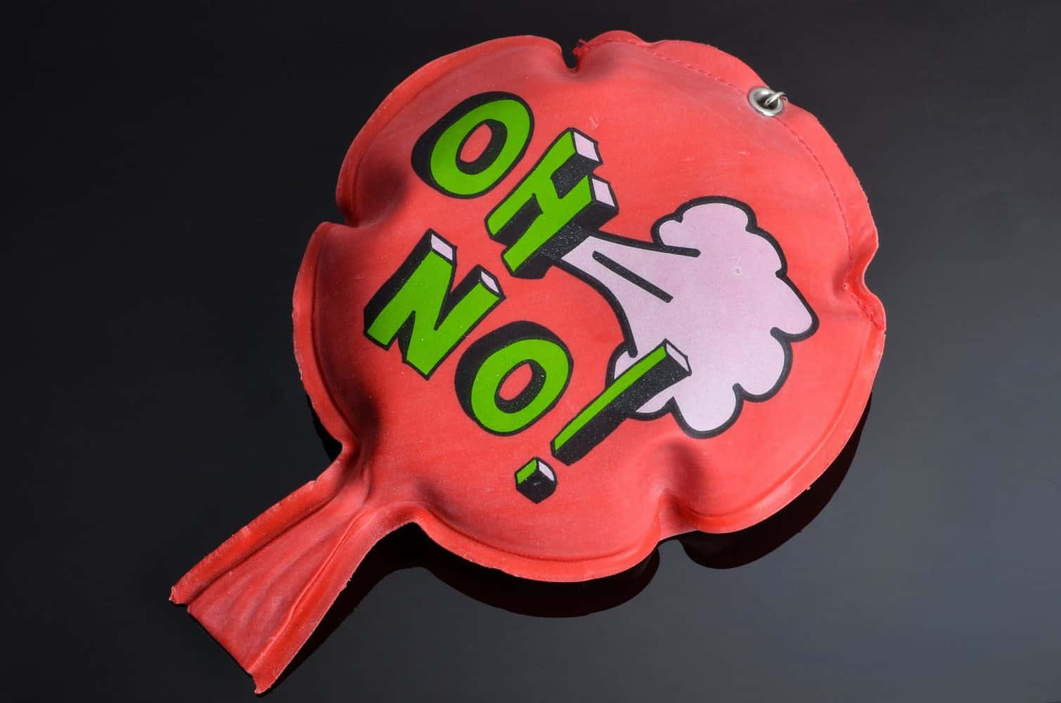 A whoopee cushion with the phrase 'Oh No!' on it.