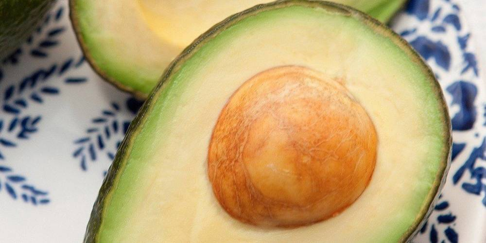 Close-up of an avocado sliced in half.