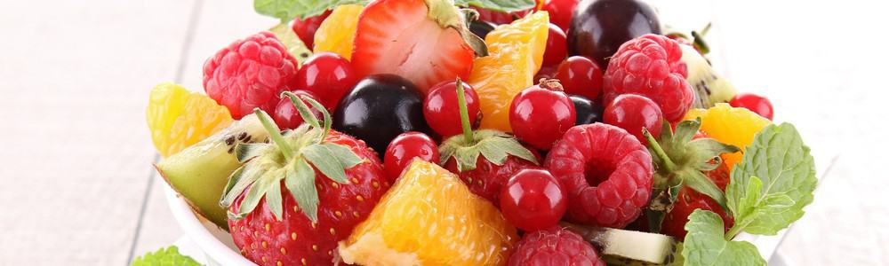 A bowl of various fruits like strawberries, raspberries, kiwi, and others.