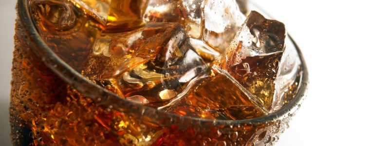 Close-up of a glass of soda with ice.