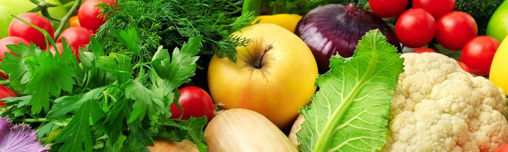 Various types of vegetables like onions, tomatoes and pumpkins.