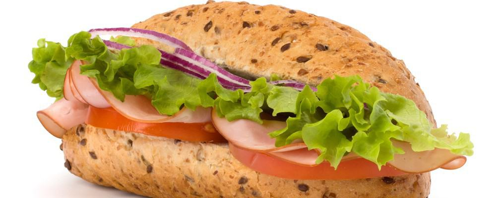 A ham, salad, and tomato sandwich.