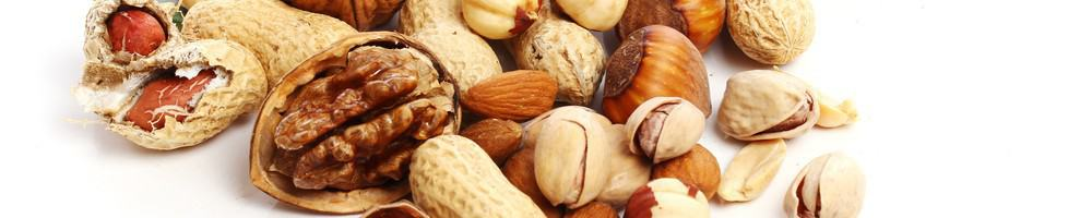 A mix of nuts including pistachios and walnuts.