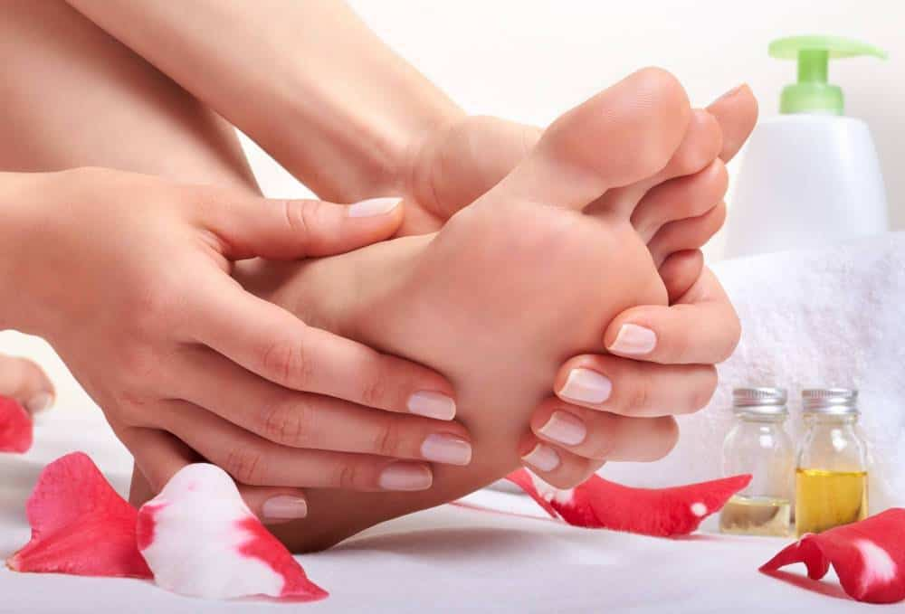 A woman rubbing her foot.