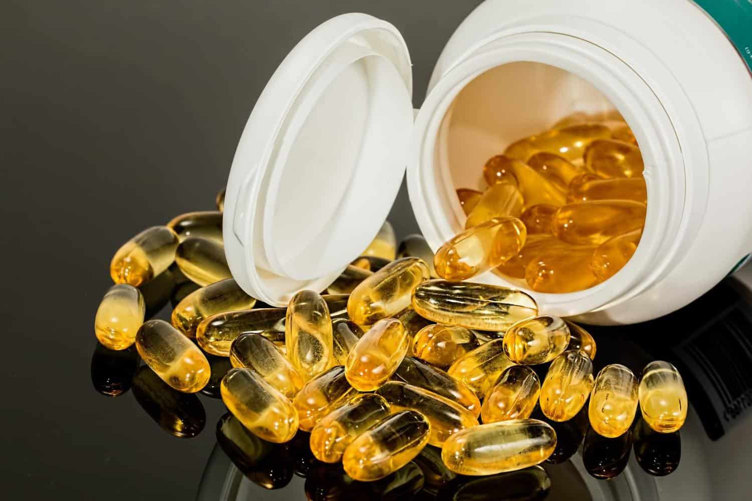 Fish oil capsules from a bottle.