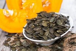 A bowl of pumpkin seeds.