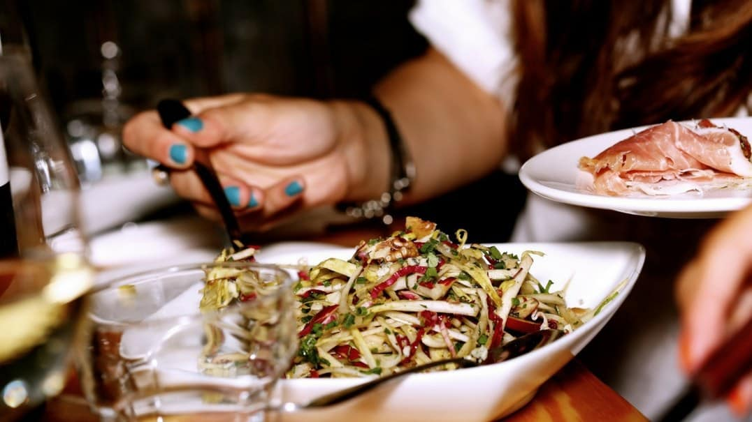 A person eating a salad.
