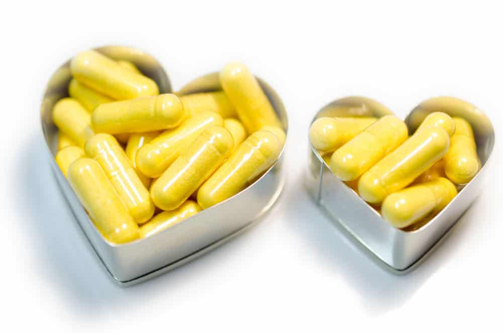 Capsules in heart-shaped containers.