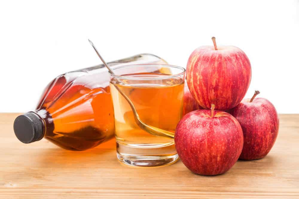 Apple cider vinegar in jar, glass and fresh apple, healthy drink.