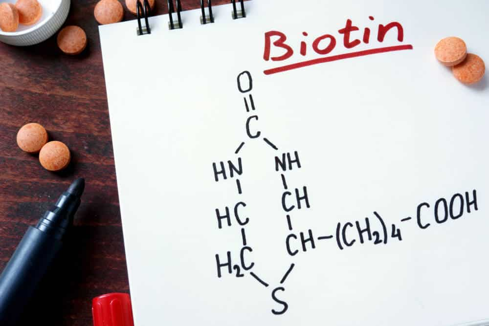 Biotin molecule structure drawn on a notebook.
